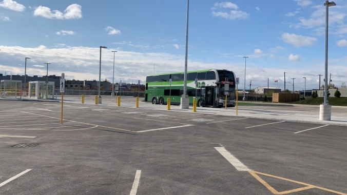 Image shows a bus stopped at a Park N Ride.