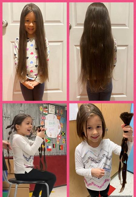 A child holds up her trimmed hair.