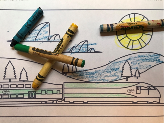 Image shows a colouring page of a train on a landscape.