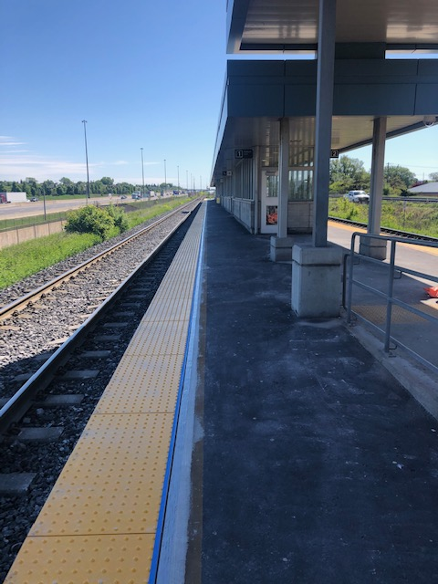 Image shows tactile yellow strips on the platform.