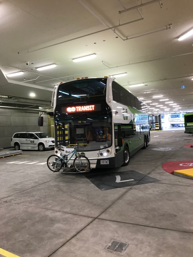 Image shows a bus moving through the terminal.