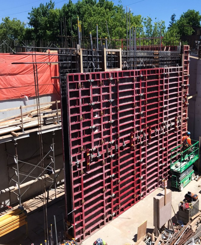 Image shows a large construction wall.