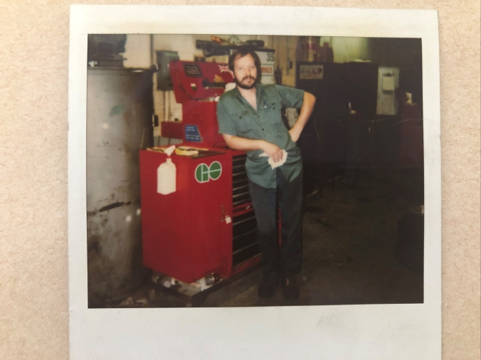 Image shows Chris posing in front of a tool chest.