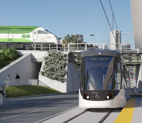Image shows an LRT arriving at a station, with a GO train in the background.