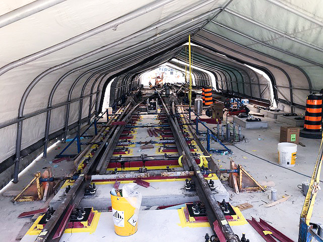 Image shows rails being installed under a covering.