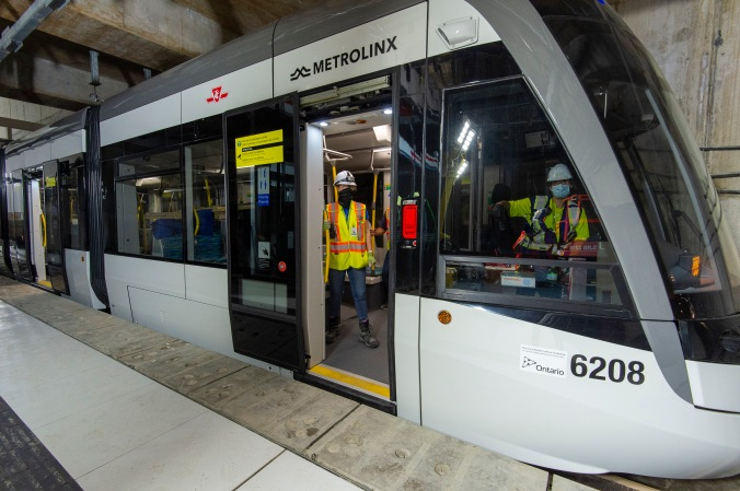 Crews sit in the parked light rail vehicle at Caledonia Station as part of recent testing