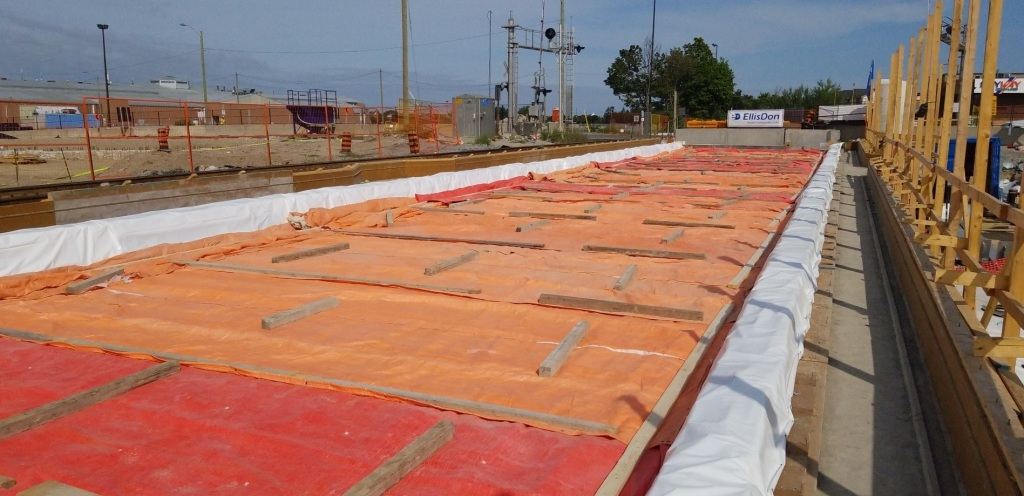 Tarps covering the bridge deck as the concrete cures