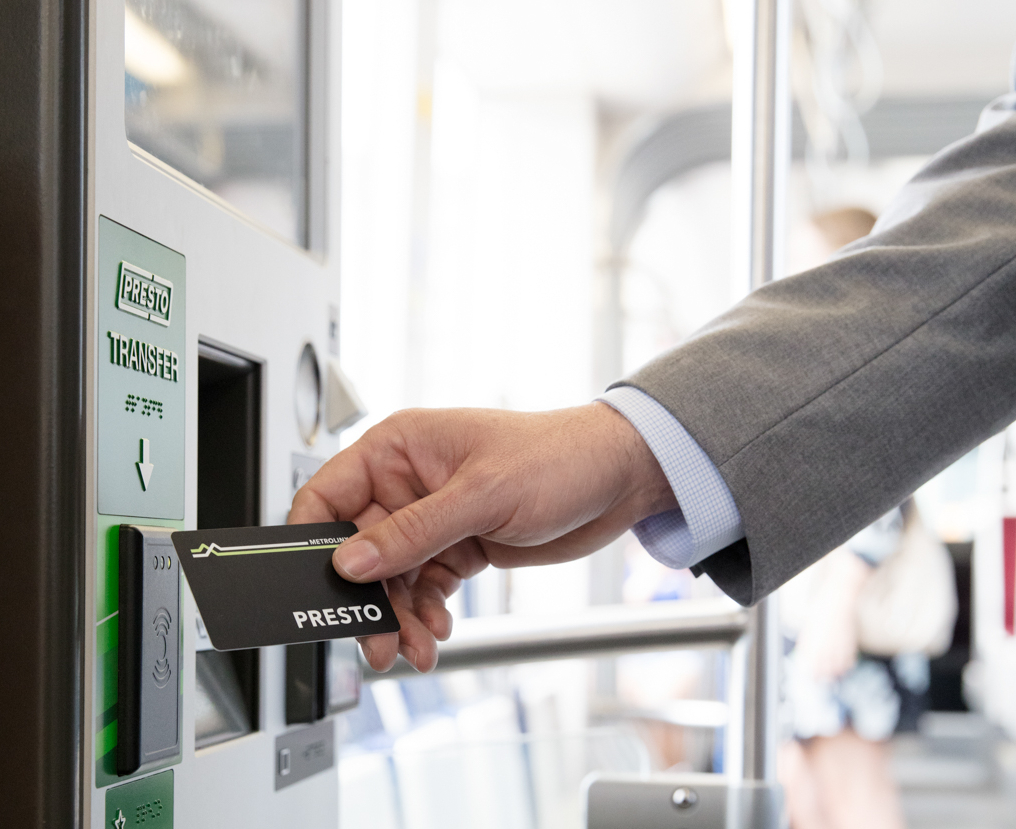 A man taps a PRESTO card.