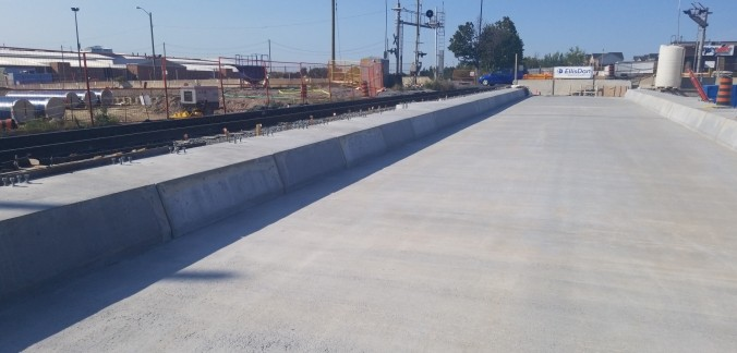 The finished concrete surface of bridge deck.