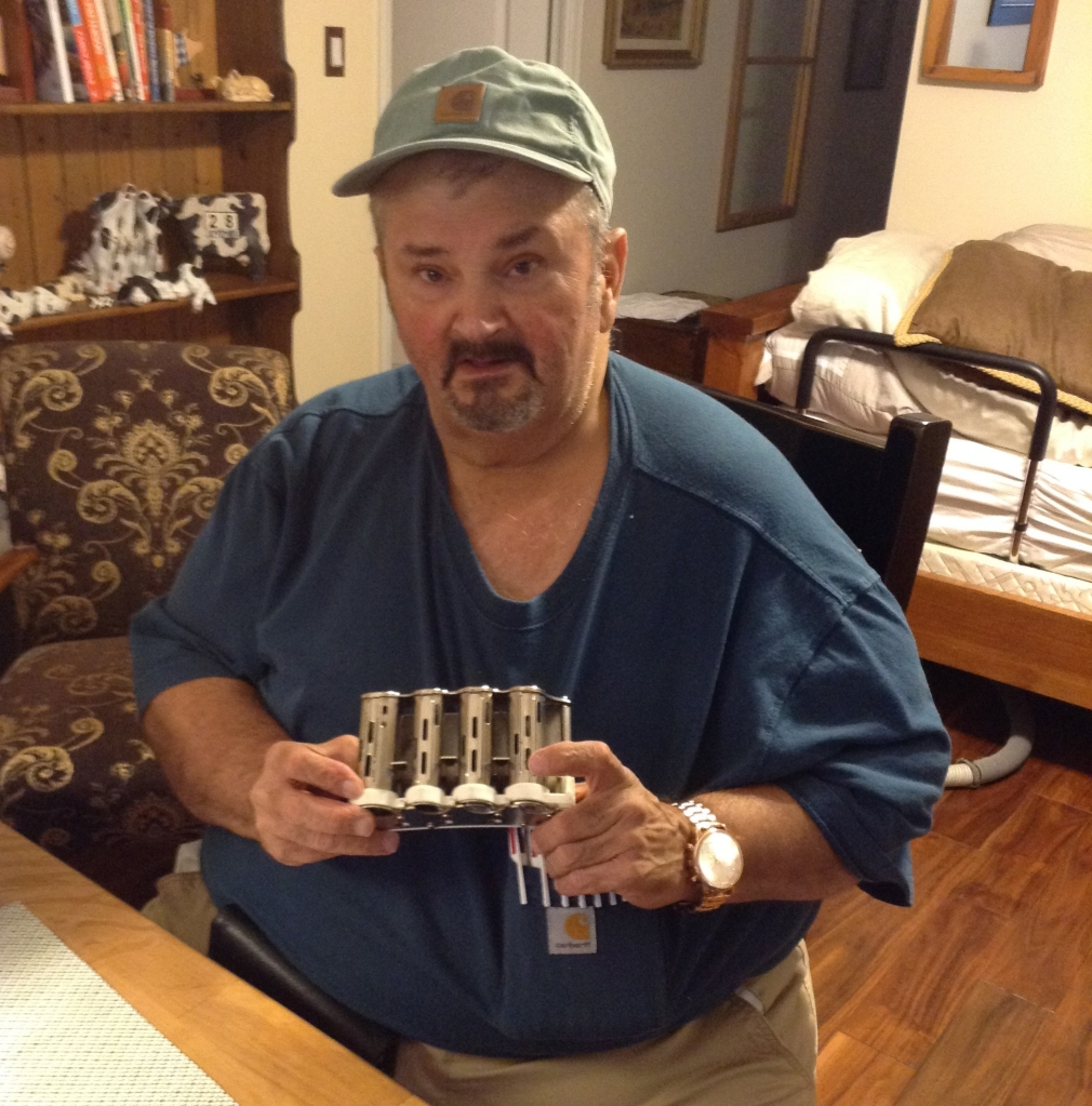 Photo of Mark Kiefer with his coin dispenser