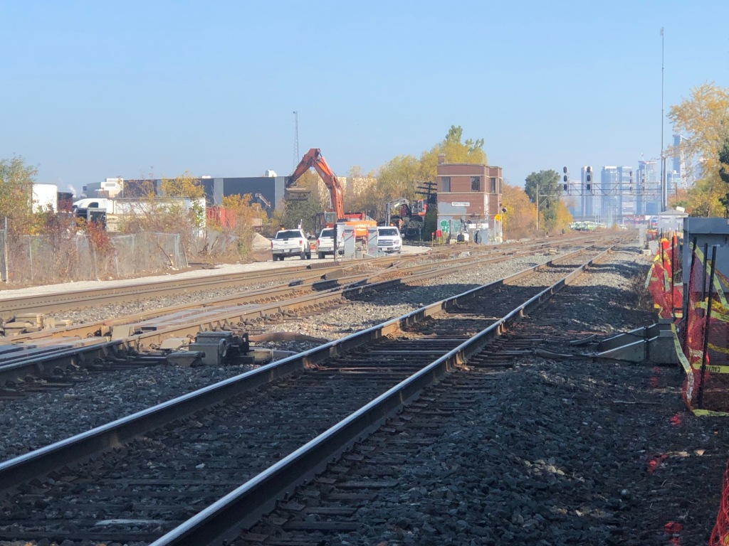 Looking east towards Toronto on the Lakeshore West GO corridor, with construction happening in the background.