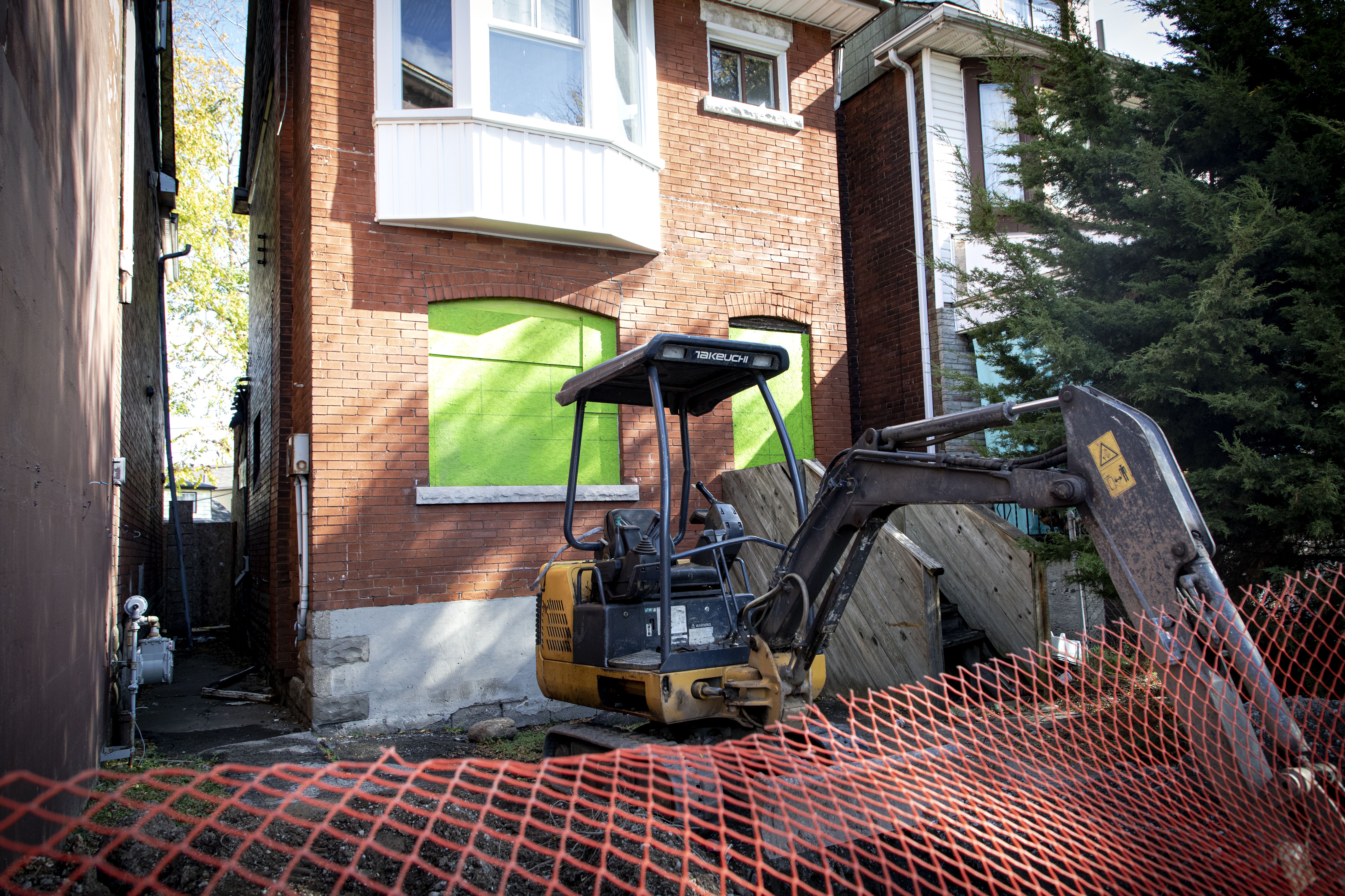 Image shows a tractor in front of a property.