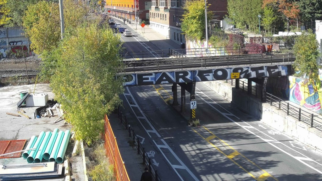 Image shows a bridge over a busy street.