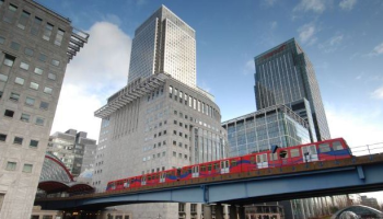 A train moves along an elevated guideway.