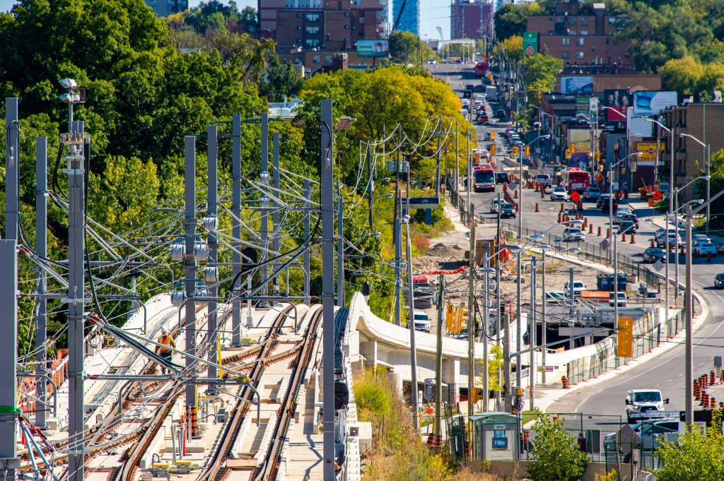 Image shows lots of wires over tracks.