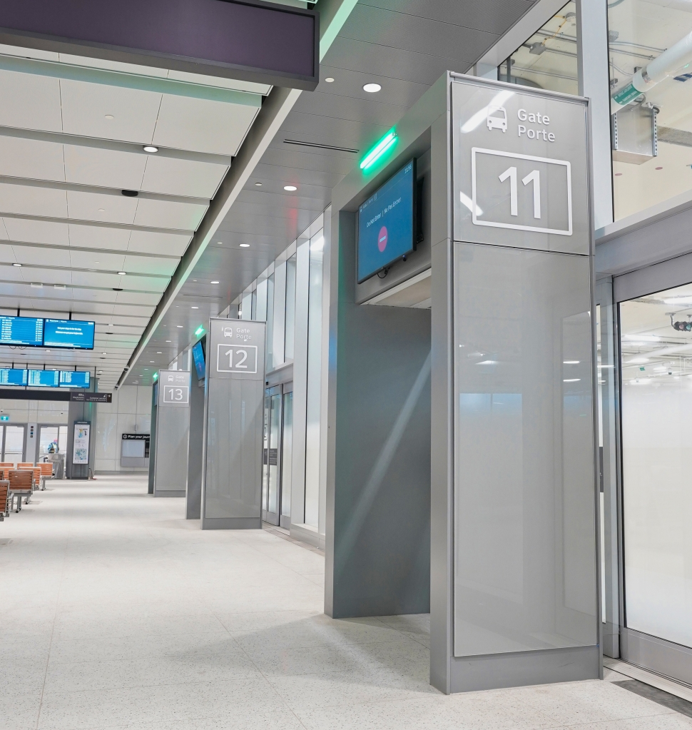photo of the departure gates where customers will wait inside for their bus