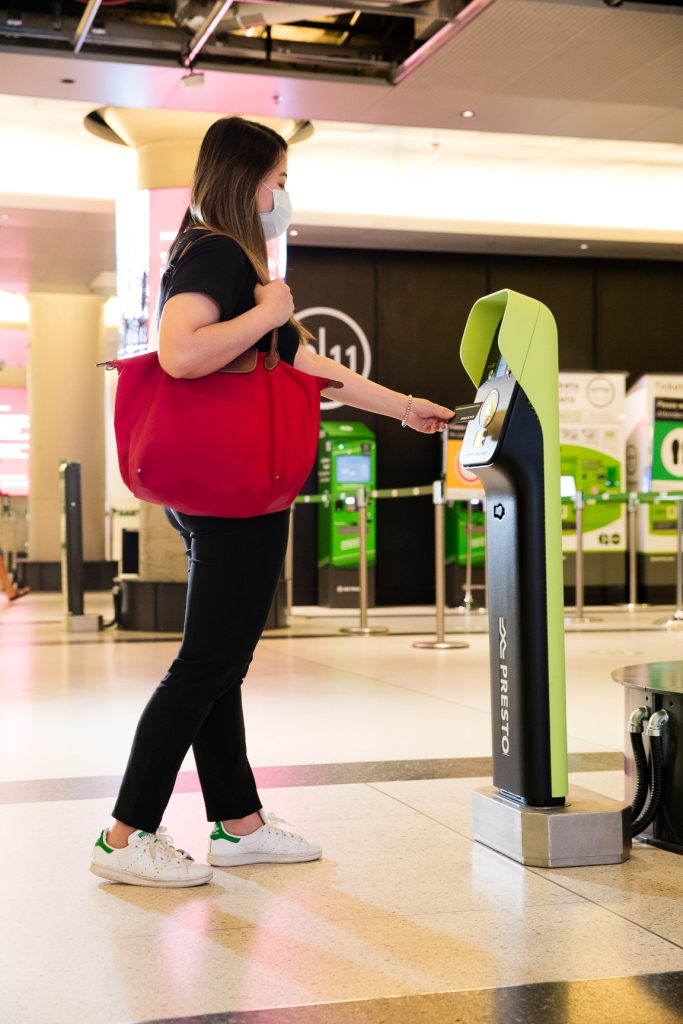 GO customer tapping their PRESTO card at Union Station