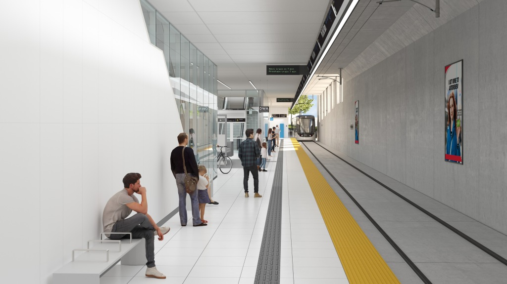 Customers wait for an incoming LRT.