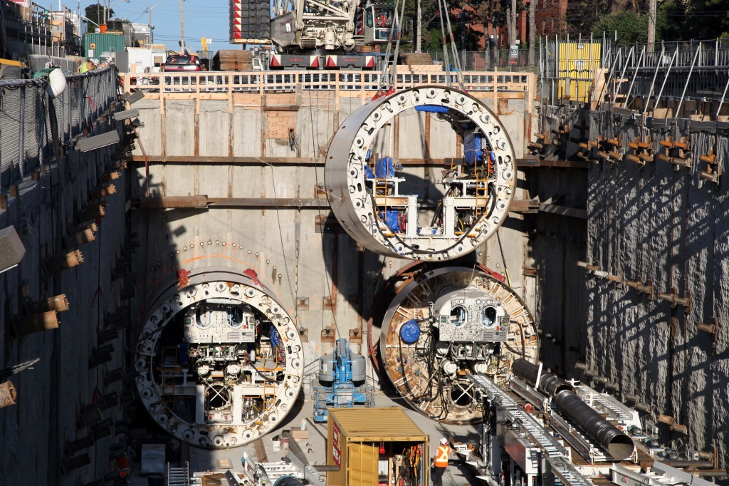 Image of a launch shaft, with tunnel boring machines being lowered, for the Eglinton Crosstown LRT.