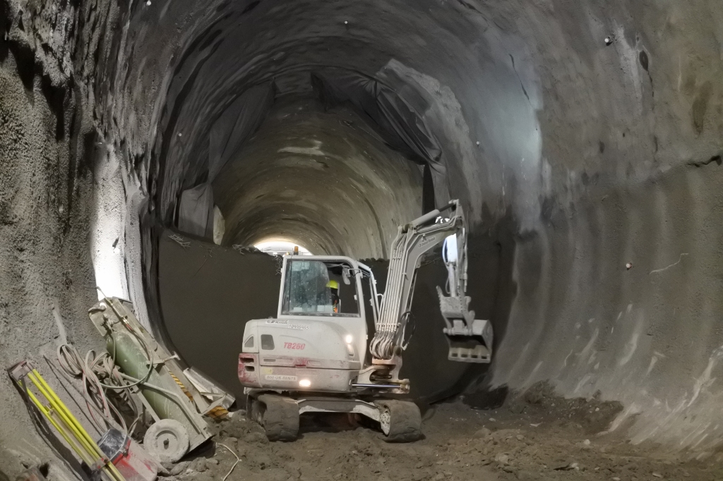 A tractor works inside a tunnel.