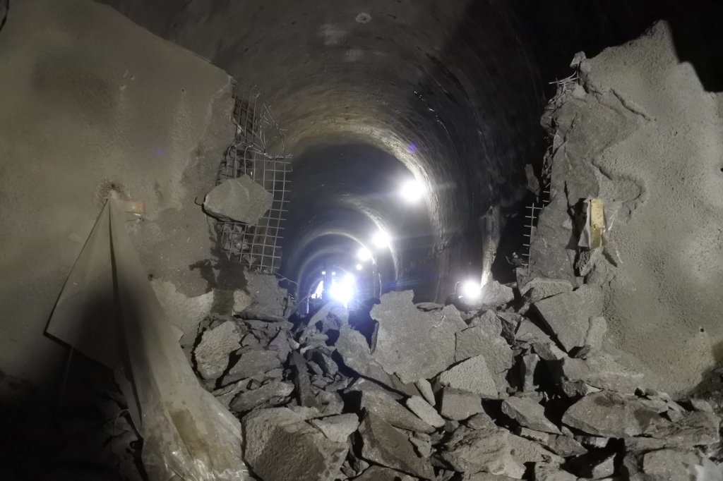 The tunnel is seen with smashed concrete.