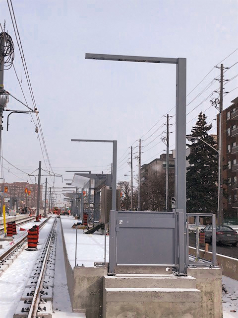 Image shows new lamp posts being put up.